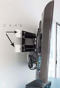 How to install a swivel TV mount for $50. Come and find out how to hide the TV cords too! | In My Own Style