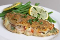 Chicken Stuffed with Pesto, Ham, and Fontina - looks amazing, will be making this weekend, for sure!