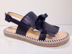 Christian Louboutin kiltie sandal with chain detail.
