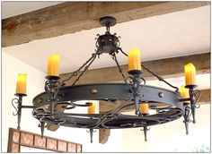 Italian Tuscan Iron Chandeliers custom frabricated by Unique Iron Lighting. Choose from a large selection of Italian and Tuscan lighting fixtures. Wrought Iron Chandeliers, Rustic Room, Tudor House, Old World Style, Iron Work, Tuscan Style, Old Barns, Home Lighting, Light Fixtures