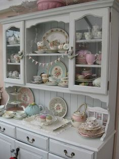 This hutch looks like it has been repainted to update its style. Very cute. Love the color combinations.