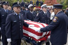 Funeral for Hartford Firefighter  Hartford and area firefighters bring the coffin of fallen Hartford firefighter Kevin Bell into First Cathedral in Bloomfield.  http://www.courant.com/community/hartford/hc-pictures-hartford-firefighter-funeral-kevin-064-photo.html