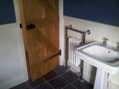 Shows towel rail over tongue and groove. tongue and groove bathroom, and towel rail. And sink. And taps Downstairs Cloakroom, Downstairs Toilet, Small Entrance, Entrance Hall, Bathroom Inspiration, Bathroom Ideas, Cottage Lounge, Tongue And Groove Walls, Cornwall Cottages