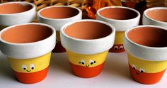 DIY Candy Corn Flower Pots #nesthappyhomes http://youtu.be/vLmFSloPmk8