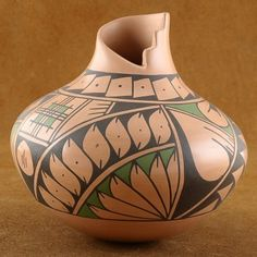Hand painted in a warm black, it is accented with Grass Green paint on a Rose-Beige background. The neck is banded in dotted diamond shaped design. This Olla pot features a nice stone polished sheen & you can still see the stone rubbing marks that remains from the polishing. These markings are subtle and add to the overall quality & beauty of the pot. $88.00 #Alltribes
