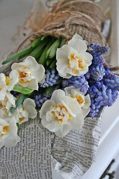 Spring lavender and white flowers in burlap wrapping..love..rustic/country