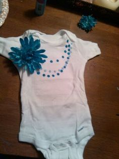 Decorative onesie with blue flower and two tones of by mexpo27, $8.99
