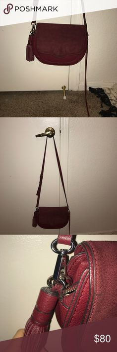 Rebecca Minkoff crossbody Rebecca Minkoff Suki cross body ! Color burgundy fabric suede. It is a bit stained in the back side because it rubs on my jeans haven't cleaned it because I know suede is very delicate and I don't want to ruin it. Also the key chain is tarnishing a bit but can be removed if one prefers to not have them hanging. It's a great cross body iv'e always received compliments on it. Very trendy i'm a fan of Rebecca Minkoff! Rebecca Minkoff Bags Shoulder Bags