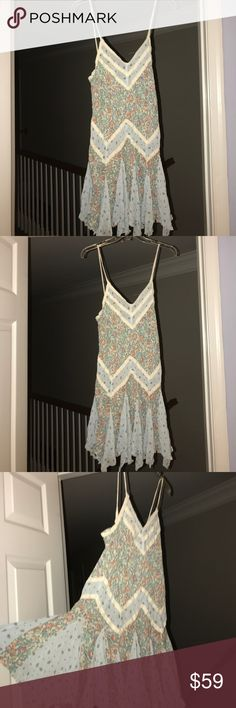 Intimate free people blue sexy Lacey summer dress Very beautiful floral with beige aligning and zigzag creations fluff at the bottom giving it a little bit of volume size small petite and very cute....  all kinds of beautiful pastel flowers perfect for spring especially if you're skinny and tan.... Free People Dresses Mini
