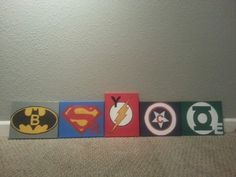Superhero hand painted canvas.  We used a template for the logo and then incorporated the letters of my son's name. My sister inlaw is pretty talented! !