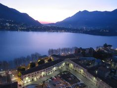 An excellent way to see Lecco and Lake Como is from above atop the bell and clock tower Campanile di San Nicolò. This is Lecco's top tourist attraction but is Lake Como Italy, Tourism, Tower, San, Travel, Outdoor, Turismo, Outdoors, Rook