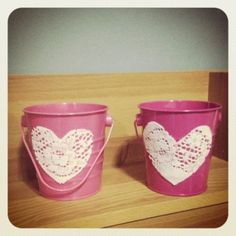 Flower Girl Pails    Kim and Almi decorated these pink pails with heart shaped lace cut-outs for their flower girls in their DIY Vintage Beach Wedding.   Photo By Almi Ilagan - Atienza