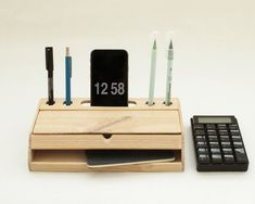 Wooden desk organizer for your office desktop to hold pens, stationery accessories, chargers and with mobile phone stand. It combines a pen case for your writing and drawing tools with docking possibilities for your digital device. Measures: L 25 x W 15 x H 5 cm
