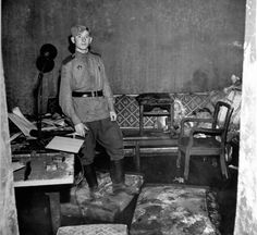 Unknown soviet soldier in the apartment of Goebbels in Hitler's bunker under the Reich Chancellery (1945)