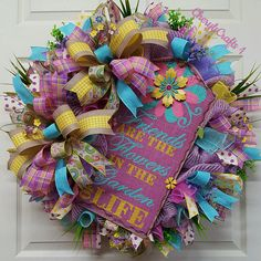 Mothers Day Wreath, Spring Wreath, Summer Wreath, Welcome Wreath, Friend Wreath, Gift for Mom, Gift for Friend, Gift for Someone Special~You  Created on a wire frame using lush~soft lavendar jute burlap for the base mesh, loads of soft and warm mesh curls in lavendar, yellow, pink and blue. Six different gorgeous ribbon prints for the bows and other decorative accents throughout, florals and greenery and of course, the inspiration for the whole wreath, the gorgeous burlap Friends are the…