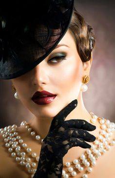 elegant woman with pearls, hat and gloves