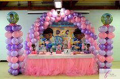 Our Doc McStuffin balloon decor set up. #balloonarch #ballooncolumns #docmcstuffin #candytable #sweetstable