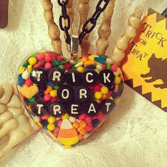 Hey, I found this really awesome Etsy listing at https://www.etsy.com/listing/109463444/trick-or-treat-candy-chaos-resin-heart