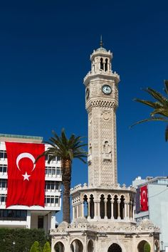Izmir clock tower with the Turkish flag in the background