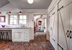 Ranch Cottage with Transitional Coastal Interiors - barn style doors