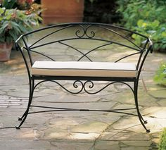 Some believe that the morning is the best time to be in the garden. Our iron bench with hand-forged scrolls is just the right spot for contemplation or daydreaming. Made in the USA, the bench has received a durable black powder coat finish. Iron Furniture, Steel Furniture, Furniture Design, Wrought Iron Bench, Wrought Iron Decor, Cottage Style Furniture, Iron Art, Pergola, Sunbrella Fabric