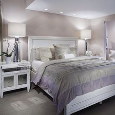 Stunning Spaces: this New Jersey beach house bedroom designed by Tracey Butler features a color palette inspired by the hues reflected off the bay at night. Features our Century Table Lamps and Concerto Nightstands. Photo: John Ferrentino