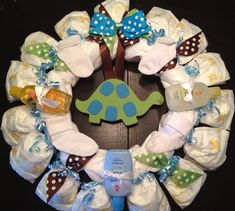 Personalized DIAPER WREATH Baby Shower Gift Custom Decoration BOY with Plaque, Initial, Dinosaur, Car, or Sailboat. $35.00, via Etsy.