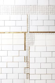 A quirky tile detail adds a graphic note to an otherwise standard subway-tiled wall. Photo by Heidi's Bridge.