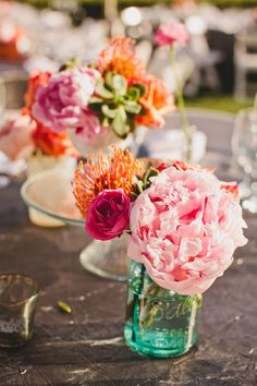 pink and orange flowers in teal mason jars // photo by Hello Studios