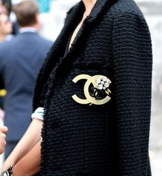 Who says you have to drop thousands to pull off the Chanel Tweed Jacket look?    Chanel Broaches run from $250+ which in the grand scheme of things isn't that much. You can buy the broach and find a cheaper tweed jacket to put it on.