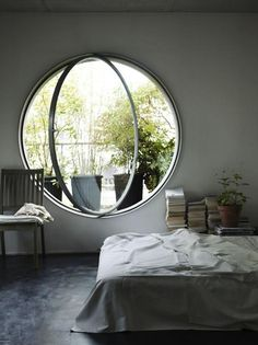 Love this total look..amazing window and looks like Chinese classical garden.