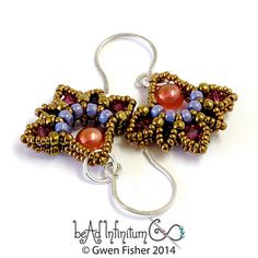 These beaded earrings feature little fan dangles in the shape of lotus flowers. They are woven with purple, peachy pink, and bronze glass beads and