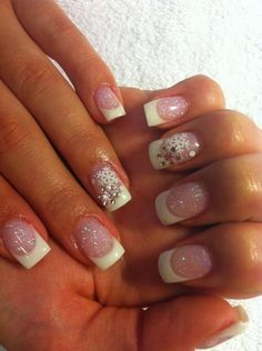 Winter nails : simple French mani with snowflakes stickons and dots with a nail art pen anyone could do that