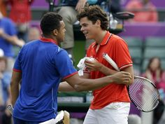 Jo-Wilfried Tsonga of France, left, talks with Milos Raonic of Canada, right, after Tsonga won their match at the All England Lawn Tennis Club at Wimbledon, in London, at the 2012 Summer Olympics, Tuesday, July 31, 2012. Tsonga won the match 6-3, 3-6, 25-23. The third set was the longest set in Olympic history.