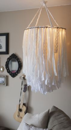 Cloth chandelier (and I love the guitar hanging from an old doorknob in the background!!)