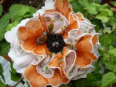Charming flower - made with vintage hankie Would be cool in bridal bouquet or on gown as something old.