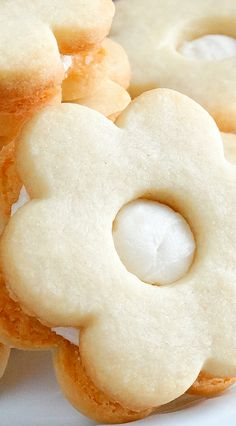 Buttered Rum Shortbread Cookies ~ Simply divine! Buttery, flavorful and fragrant, these rum butter cookies are the embodiment of a truly melt-in-your-mouth, delicate yet crisp, shortbread cookie. Sandwiched with a dreamy, soft and creamy rum buttercream filling for the ultimate taste sensation. Everyone will LOVE them. Irresistible! #Christmas #Holidays cookie recipe