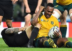 Australia's centre Tevita Kuridrani (right) reacts after scoring his team's second try during the final