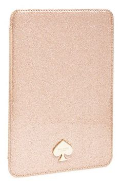 Keep your iPad chic and scratch-free in a glittering case with a goldtone kate spade new york logo.