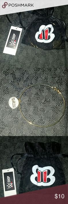 WWE FEARLESS NIKKI BANGLE Gold bracelet/bangle, bought it and it was too big for me. New with tag and in the bag. Feel free to ask me questions or offer a reasonable price. WWE Jewelry Bracelets