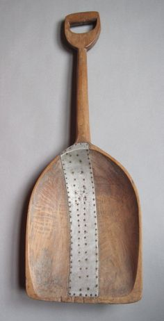 repaired wooden scoop