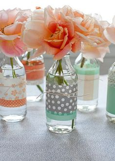 Use old glass jars or mason jars to display fresh cut flowers. Add a colorful print around the bottle, or even some burlap for a country touch!