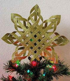 DIY Woven Paper Star Star Tree Topper   15 DIY Christmas Tree Topper Ideas, check it out at http://diyready.com/diy-christmas-tree-topper-ideas
