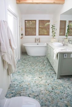 Exotic Beauty: Beachy hues in this pebble flooring from Island Stone