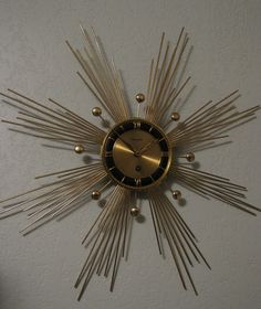 (When we were kids, my sister and I 'bought' one like this with trading stamps for our parents for Christmas) Century Atomic Sun/Starburst Wall clock by Forestville