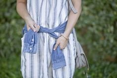Denim shirt tied around the waist.