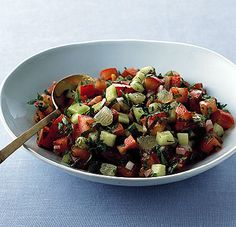 Arabic salad; cucumber, onion, parsley, olive oil, and tomatoes! So good!!          Chopped Arabic Salad Recipe  at Epicurious.com