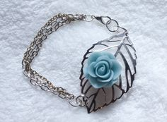 silver filigree leaf with blue polymer clay rose and 3 strands