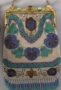Antique floral micro beaded bag including fringe.