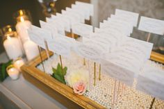 escort cards - photo by Mango Studios - ruffledblog.com/ontario-flower-child-wedding/